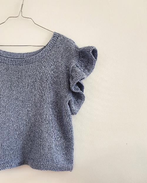 Opskrift på strikket bluse med flæser